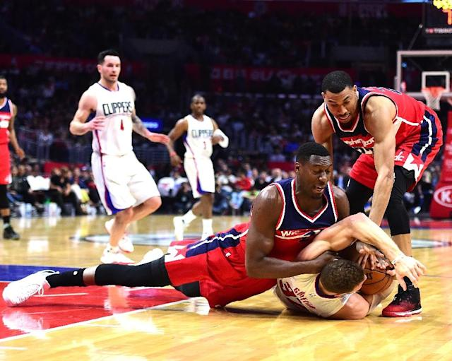 Ian Mahinmi of the Washington Wizards (L), pictured in March 2017, missed the first 14 games of the season after left knee surgery and was sidelined for another six weeks from December to February for knee treatments (AFP Photo/Harry How)