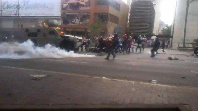 Armoured vehicle runs over protesters in Venezuela