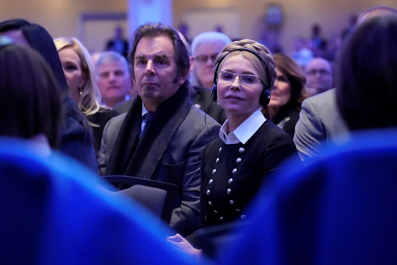 Ukraine's former Prime Minister Yulia Tymoshenko, seated with musician Jonathan Cain of the band Journey, attends the National Prayer Breakfast in Washington, U.S. February 8, 2018. REUTERS/Jonathan Ernst
