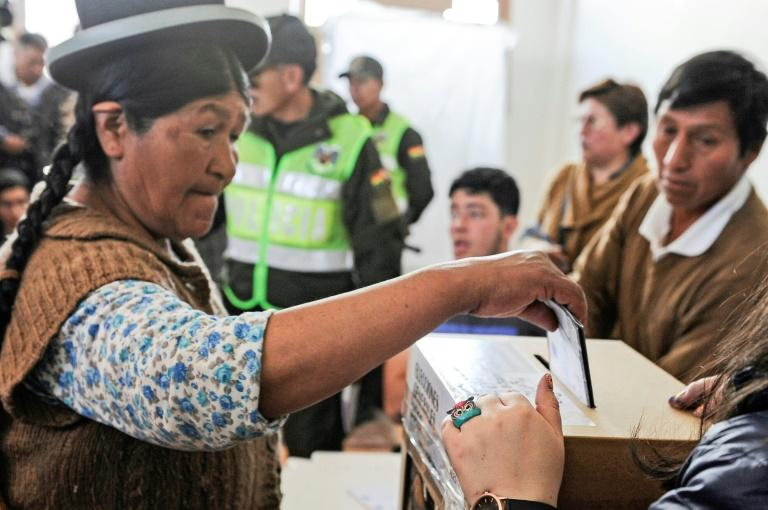 The second round of Bolivia's presidential election will take place on December 15 (AFP Photo/JORGE BERNAL)