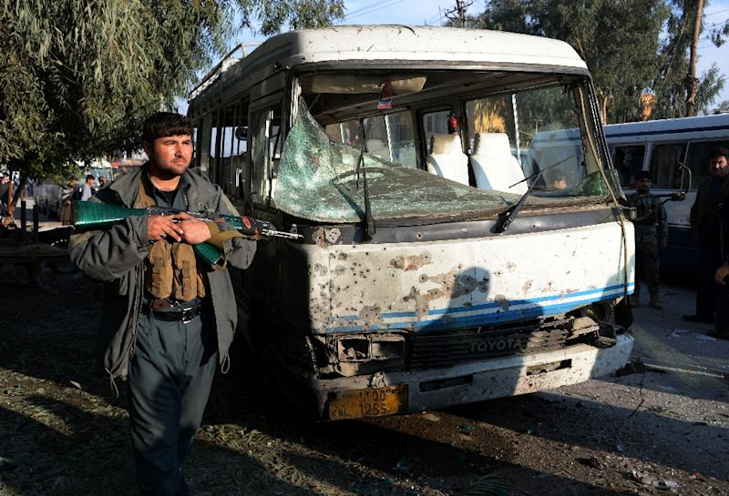 A member of the Afghan security forces stands guard near the site of a suicide attack in Jalalabad on November 23, 2017