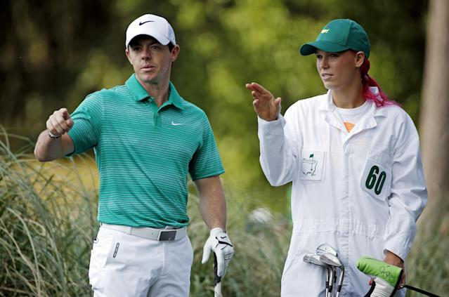 Tennis player Caroline Wozniacki talks with her fiancee Rory McIlroy, of Northern Ireland, during the par three competition at the Masters golf tournament Wednesday, April 9, 2014, in Augusta, Ga. (AP Photo/Matt Slocum)