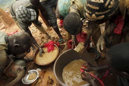 Gold prospectors are seen at a gold mine near the village of Gamina, in western Ivory Coast, March 16, 2015. REUTERS/Luc Gnago