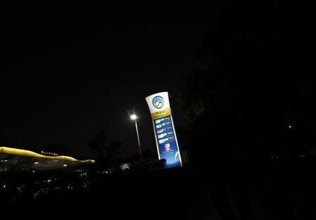 A Bharat Petroleum oil pump station displays the price of unleaded petrol and Diesel in New Delhi