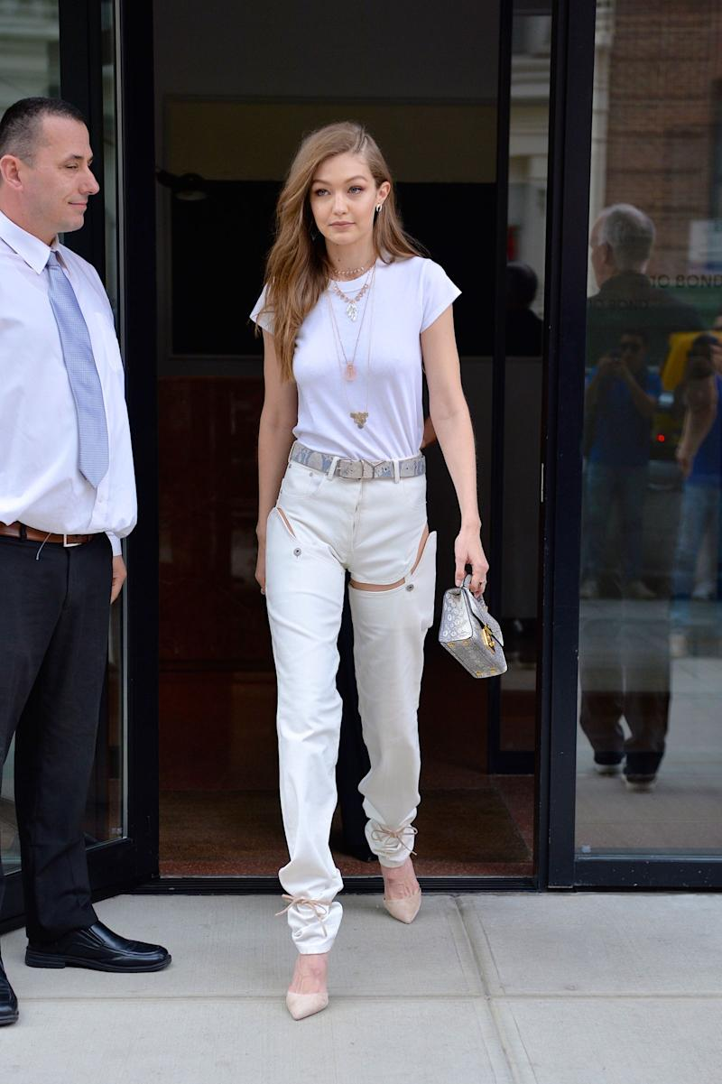 As a professional outfit-wearer, Gigi can pull off <em>anything </em><span>– including the 2017 version of those zip-off-at-the-knee pants from your childhood. Her all-white ensemble was anything but boring with these negative space booty short-jeans. </span>