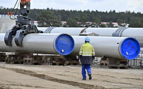 (FILES) In this file photo taken on March 26, 2019, a man works at the construction site of the Nord Stream 2 gas pipeline in Lubmin, northeastern Germany. - The German-Russian Chamber of Commerce on December 12, 2019 called for retaliatory sanctions after US lawmakers gave initial approval to a bill that would punish contractors working on a Russian pipeline to Germany. (Photo by Tobias SCHWARZ / AFP) (Photo by TOBIAS SCHWARZ/AFP via Getty Images) - Credit: TOBIAS SCHWARZ/AFP