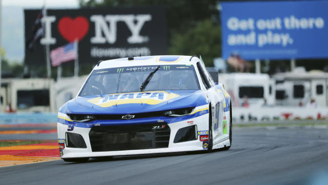 """Chase Elliott (9) drives through the area of the course called """"The Bus Stop"""" during a practice run for the NASCAR Cup Series auto race at Watkins Glen International, Saturday, Aug. 3, 2019, in Watkins Glen, New York. (AP Photo/John Munson)"""