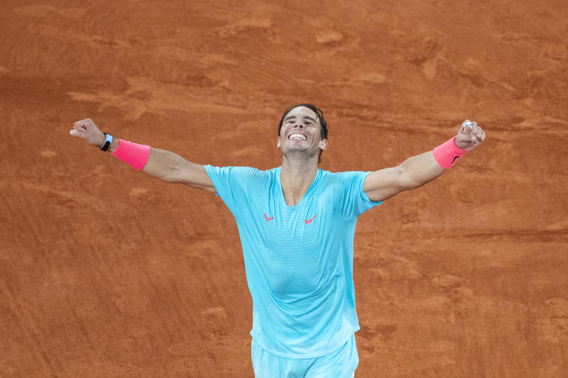Rafael Nadal celebrates his victory against Novak Djokovic in the Singles Final on Court Philippe-Chatrier during the French Open.