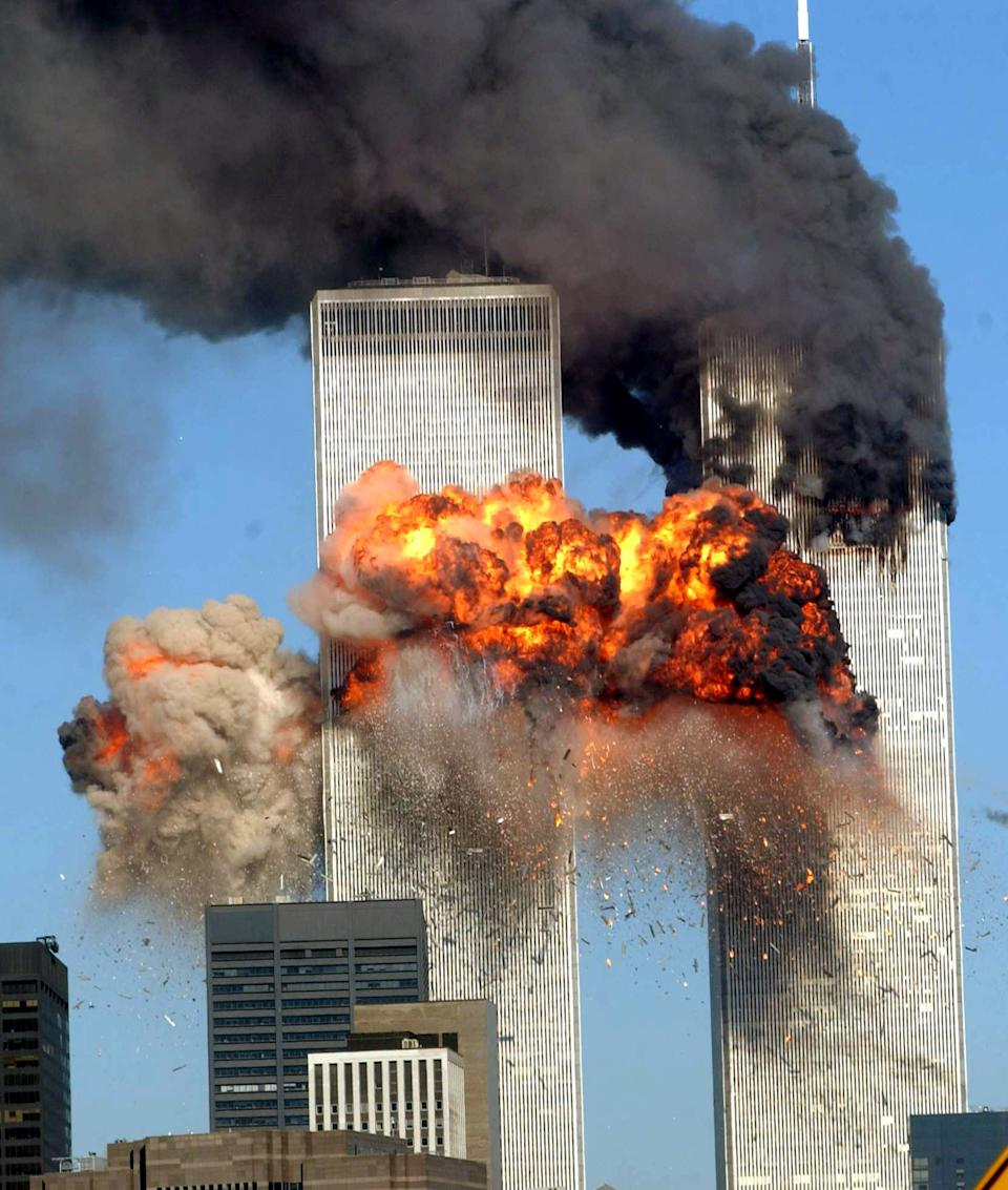 <p>A fiery blasts rocks the south tower of the World Trade Center as the hijacked United Airlines Flight 175 from Boston crashes into the building. (Getty)</p>