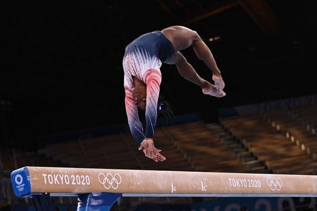 Simone Biles competes in the artistic gymnastics women's balance beam final of the Tokyo 2020 Olympic Games at Ariake Gymnastics Centre in Tokyo on Aug. 3, 2021. (Photo: LIONEL BONAVENTURE via Getty Images)