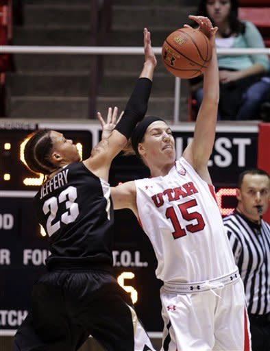 Utah forward Michelle Plouffe (15) pulls down a pass as Colorado guard Chucky Jeffery (23) defends during the first half of an NCAA college basketball game, Sunday, Jan. 13, 2013, in Salt Lake City. (AP Photo/Rick Bowmer)