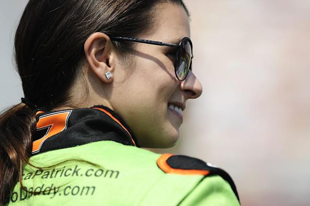 CONCORD, NC - MAY 26: Danica Patrick, driver of the #7 GoDaddy.com Chevrolet, stands on the grid during qualifying for the NASCAR Nationwide Series History 300 at Charlotte Motor Speedway on May 26, 2012 in Concord, North Carolina. (Photo by Jared C. Tilton/Getty Images for NASCAR)