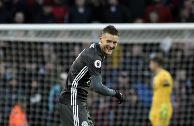 Leicester's Jamie Vardy smiles after scoring his side's fourth goal during the English Premier League soccer match between Aston Villa and Leicester City at Villa Park in Birmingham, England, Sunday, Dec. 8, 2019. (AP Photo/Rui Vieira)