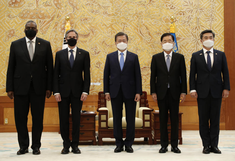 South Korean President Moon Jae-in, center, stands for the media with U.S. Secretary of State Antony Blinken, second from left, U.S. Defense Secretary Lloyd Austin, left, South Korean Foreign Minister Chung Eui-yong, second from right, and South Korean Defense Minister Suh Wook before their meeting at the presidential Blue House in Seoul, South Korea, Thursday, March 18, 2021. (AP Photo/Lee Jin-man, Pool)
