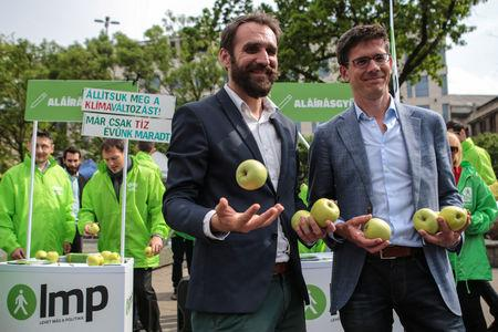Members of the European Greens party Gabor Vago and Bas Eickhoutcampaignfor the European Elections in Budapest, Hungary May 3, 2019. Gabor Banko/LMP/Handout via REUTERS