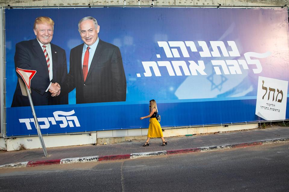 """An election campaign billboard promotes Israeli Prime Minister Benjamin Netanyahu with President Donald Trump in Tel Aviv on Sept 15, 2019. In Hebrew, the billboard reads, """"Netanyahu, in another league."""""""