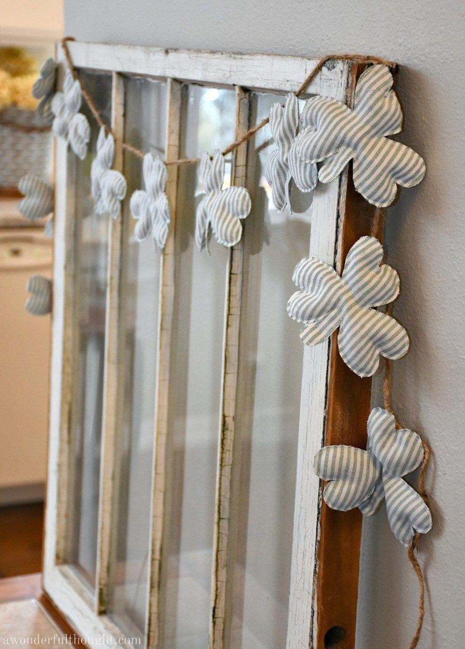 """<p>A rice-filled, cardstock garland makes a subtle St. Patrick's Day statement, meaning you can win holiday decorating points without having to go overboard. </p><p><strong>Get the tutorial at <a href=""""https://awonderfulthought.com/farmhouse-shamrock-garland/?utm_medium=social&utm_source=pinterest&utm_campaign=tailwind_tribes&utm_content=tribes&utm_term=305493394_8753474_368507"""" rel=""""nofollow noopener"""" target=""""_blank"""" data-ylk=""""slk:A Wonderful Thought"""" class=""""link rapid-noclick-resp"""">A Wonderful Thought</a>. </strong></p><p><strong><a class=""""link rapid-noclick-resp"""" href=""""https://www.amazon.com/Happy-Belly-Jasmine-Rice/dp/B08B217JP5/ref=sr_1_8?tag=syn-yahoo-20&ascsubtag=%5Bartid%7C10050.g.4035%5Bsrc%7Cyahoo-us"""" rel=""""nofollow noopener"""" target=""""_blank"""" data-ylk=""""slk:SHOP RICE"""">SHOP RICE</a><br></strong></p>"""