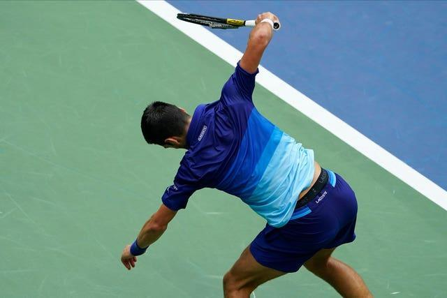 Novak Djokovic smashes his racket early in the second set
