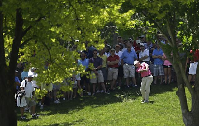 Steve Stricker hits to the second green during the second round of the Memorial golf tournament Friday, May 30, 2014, in Dublin, Ohio. (AP Photo/Darron Cummings)