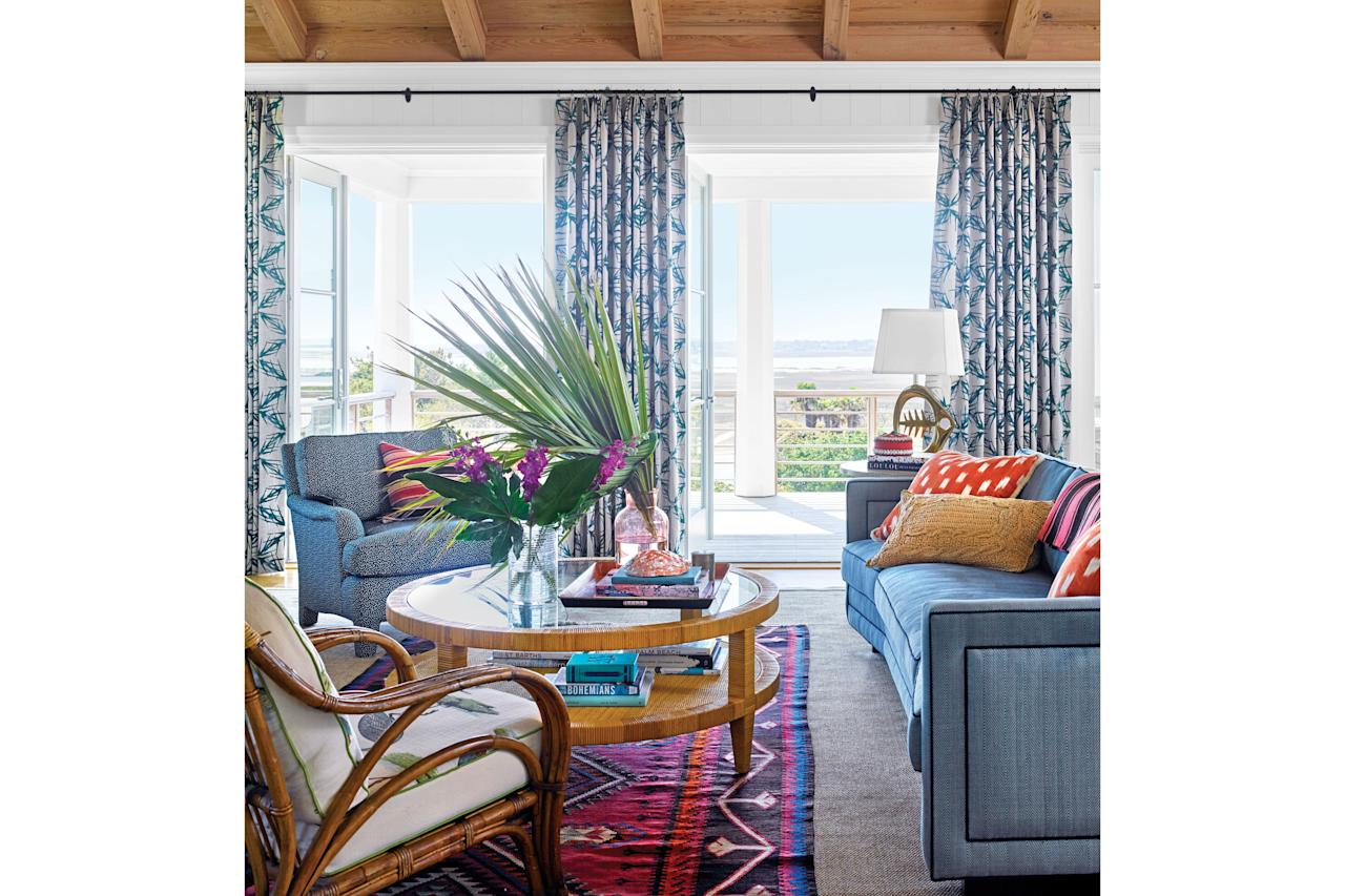 """<p>With two young boys plus visitors all summer long, """"nothing could be too precious,"""" says designer <a href=""""http://www.barriebenson.com/"""">Barrie Benson</a> of the living room furniture, which features indoor/outdoor fabrics that stand up to everything from damp bathing suits to spills. Barrie layered a rug over the woven sisal by <a href=""""https://fibreworks.com/"""">Fibreworks</a> """"because layered rugs feel more vintage,"""" she says.</p>"""