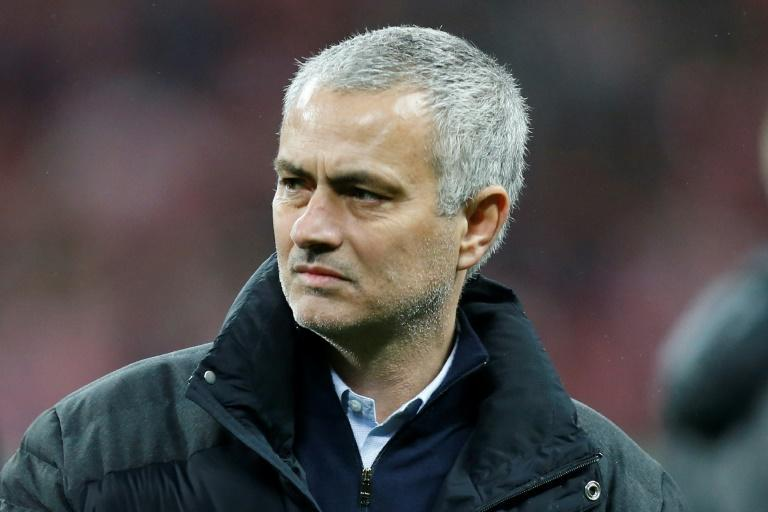 Manchester United's manager Jose Mourinho watches the celebrations on the pitch after their victory in the English League Cup final football match against Southampton February 26, 2017