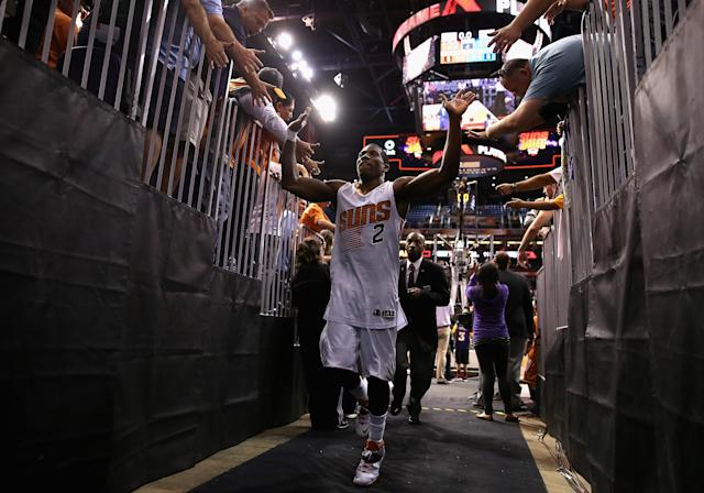 PHOENIX, AZ - APRIL 06: Eric Bledsoe #2 of the Phoenix Suns high fives fans as he runs off the court following the NBA game against the Oklahoma City Thunder at US Airways Center on April 6, 2014 in Phoenix, Arizona. The Suns defeated the Thunder 122-115. NOTE TO USER: User expressly acknowledges and agrees that, by downloading and or using this photograph, User is consenting to the terms and conditions of the Getty Images License Agreement. (Photo by Christian Petersen/Getty Images)