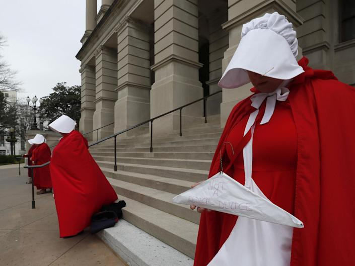 Georgia members of the Handmaid Coalition protest the passage of the 'fetal heartbeat bill' banning abortions after six weeks on International Women's Day, 2019: AP