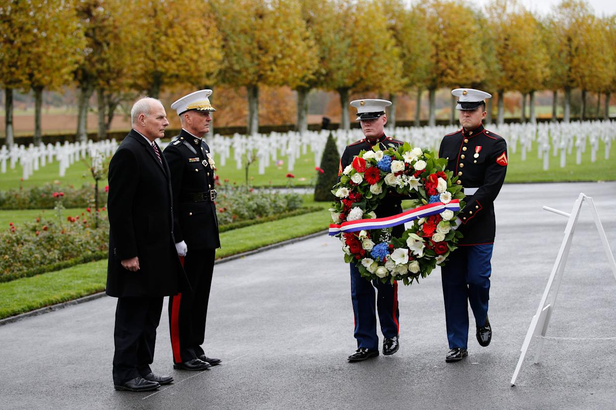 White House chief of staff John Kelly (left) and Chairman of the Joint Chiefs of Staff Marine Gen. Joseph Dunford attend a ceremony at the Aisne-Marne American Cemetery near the Belleau Wood battleground, in Belleau, France, on Saturday. (Photo: THE ASSOCIATED PRESS)