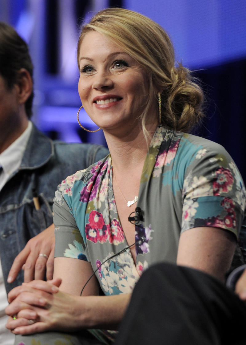 """FILE - This Aug. 1, 2011 file photo shows actress Christina Applegate, a cast member in the television series """"Up All Night,"""" taking part in a panel discussion on the show at the NBC Universal summer press tour in Beverly Hills, Calif. Applegate, 40, was diagnosed with breast cancer at age 36 and underwent a double mastectomy. To help raise money during Breast Cancer Awareness month for her Right Action for Women charity, Applegate will wear the sneakers, headbands and jog bra that sportswear brand ASICS has made as fundraising items in a special-edition partnership. The items are on sale through Oct. 31. (AP Photo/Chris Pizzello, file)"""