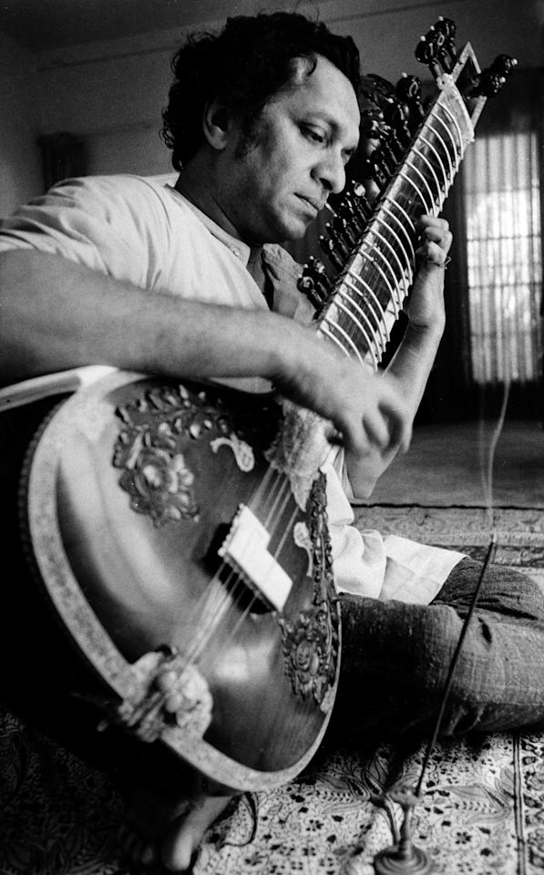 FILE - In this 1967 file photo, Ravi Shankar plays his sitar in Los Angeles. Shankar, the sitar virtuoso who became a hippie musical icon of the 1960s after hobnobbing with the Beatles and who introduced traditional Indian ragas to Western audiences over an eight-decade career, died Tuesday, Dec. 11, 2012. He was 92. (AP Photo, File)