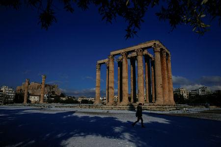 A visitor makes her way inside the archaeological site of the ancient Temple of Zeus following a snowfall in Athens, Greece, January 8, 2019. REUTERS/Alkis Konstantinidis