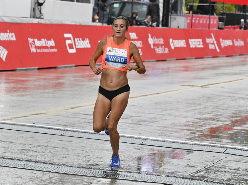 FILE - In this Oct. 7, 2018, file photo, Taylor Ward, of the United States, finishes in seventh place in the Chicago Marathon in Chicago. With next years Olympic marathon trial occurring in late February, Taylor Ward wanted to find a race that would give her an idea on what it will take to prepare. She found it in the Los Angeles Marathon. (AP Photo/Matt Marton, File)