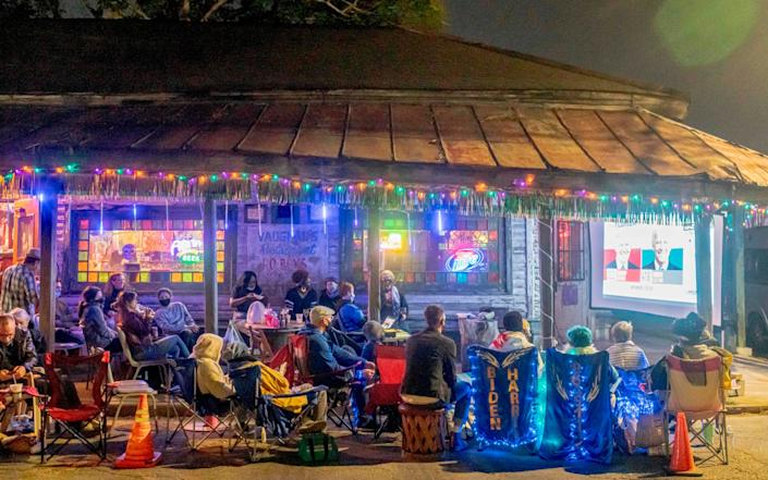 Bywater neighbors watch the election results from Vaughan's Lounge in New Orleans, Louisiana - AFP