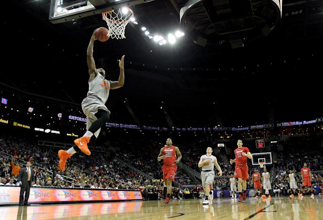 KANSAS CITY, MO - MARCH 12: Marcus Smart #33 of the Oklahoma State Cowboys scores on a fast break during the Big 12 Basketball Tournament first round game against the Texas Tech Red Raiders at the Sprint Center on March 12, 2014 in Kansas City, Missouri. (Photo by Jamie Squire/Getty Images)