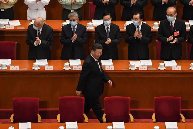Chinese President Xi Jinping arrives for the opening session of the National People's Congress on Thursday. Source: Getty