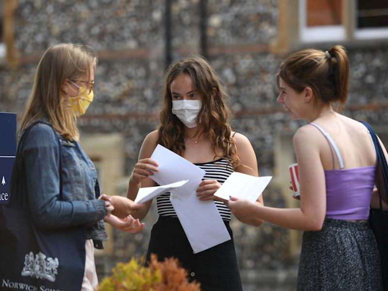 Benita Stipp (centre) and Mimi Ferguson (left) react as students at Norwich School, Norwich, receive their A-Level results: PA