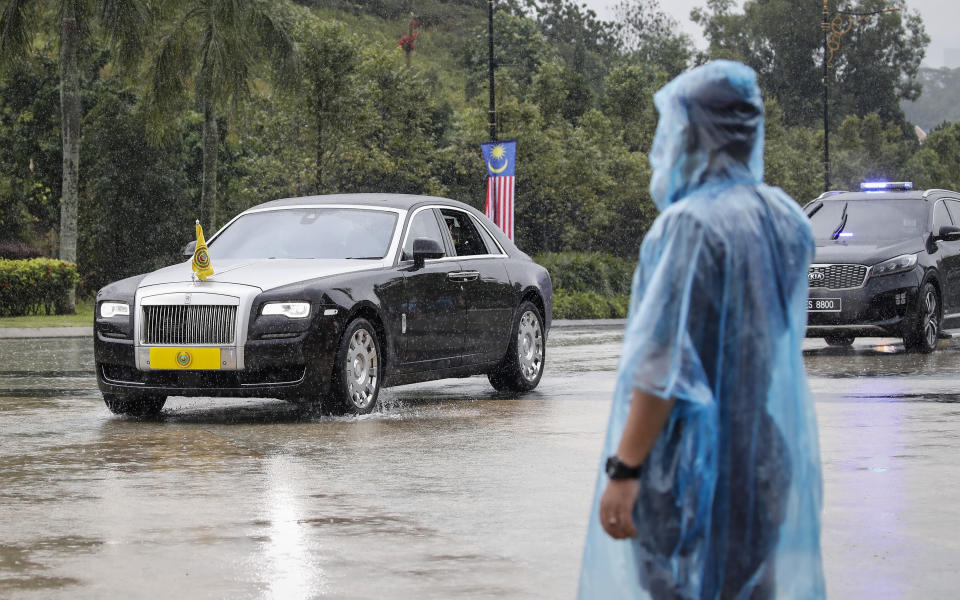 State ruler of Kedah's vehicle arriving at the National Palace in Kuala Lumpur, Malaysia, Friday, Aug. 20, 2021. Malaysian state royals are meeting Friday at the national palace to discuss the appointment of a new prime minister, with the likely choice stirring public anger and warnings of more political instability. (AP Photo/FL Wong)