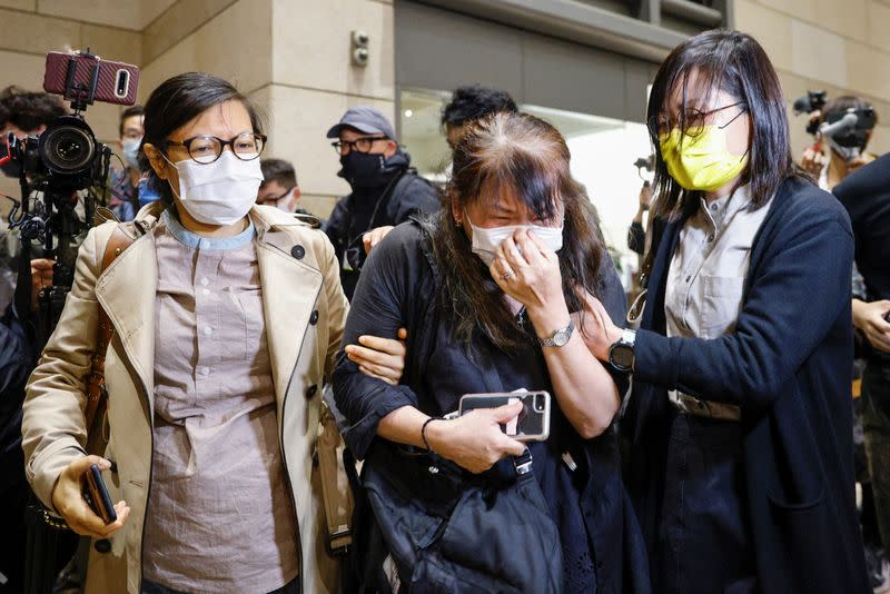 Supporter of pro-democracy activists cries after court grants bail to 15 of 47 democracy activists charged with subversion over national security law at West Kowloon Magistrates' Courts, in Hong Kong