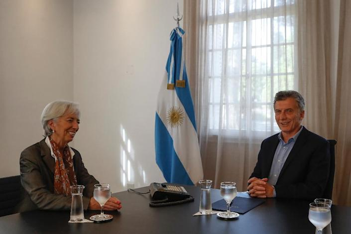 Argentina's President Mauricio Macri met in March with IMF Managing Director Christine Lagarde, and has now announced plans to seek a loan from the Washington-based lender (AFP Photo/Davis FERNANDEZ)
