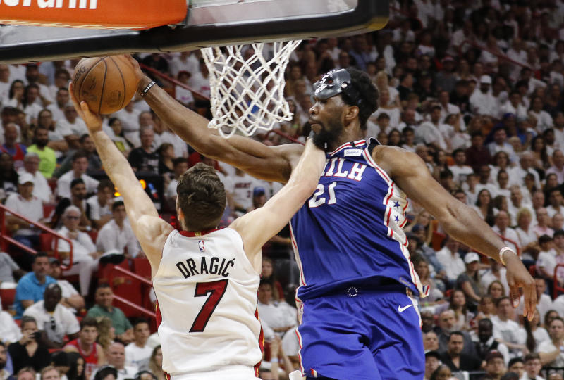 Mask or no mask, Joel Embiid's ready to take the 76ers to Round 2 ... and beyond. (AP)
