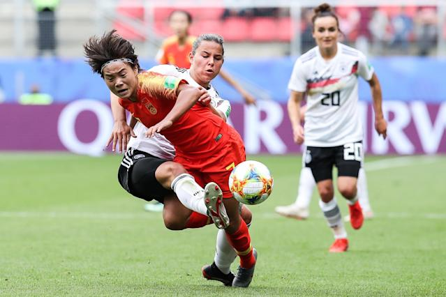 #7 Wang Shuang of China competes for the ball with #6 Lena Oberdorf of Germany during the 2019 FIFA Women's World Cup France group B match between Germany and China PR at Roazhon Park on June 08, 2019 in Rennes, France. (Photo by Zhizhao Wu/Getty Images)