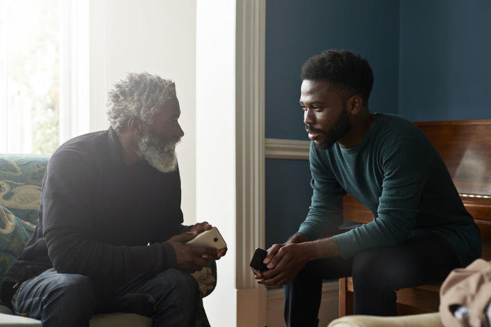 Male friends talking while sitting in living room (Klaus Vedfelt / Getty Images)