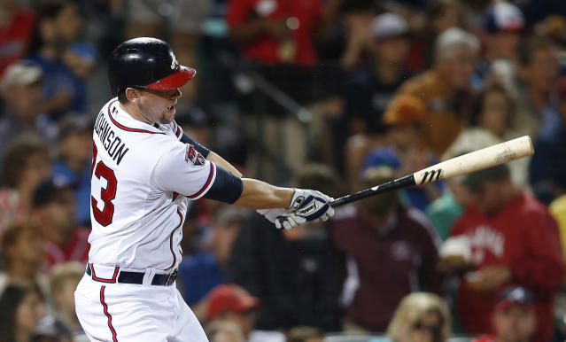 Atlanta Braves' Chris Johnson follows through with a two-RBI single in the third inning of a baseball game against the Chicago Cubs, Friday, May 9, 2014, in Atlanta. (AP Photo/John Bazemore)