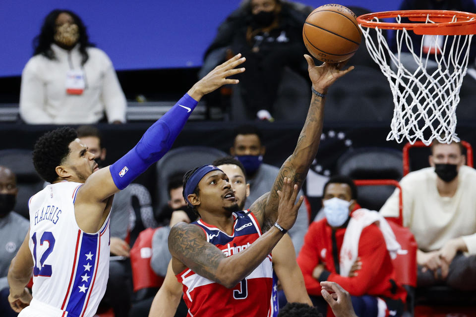 PHILADELPHIA, PENNSYLVANIA - JANUARY 06: Bradley Beal #3 of the Washington Wizards shoots a lay up past Tobias Harris #12 of the Philadelphia 76ers during the second quarter at Wells Fargo Center on January 06, 2021 in Philadelphia, Pennsylvania. NOTE TO USER: User expressly acknowledges and agrees that, by downloading and or using this photograph, User is consenting to the terms and conditions of the Getty Images License Agreement. (Photo by Tim Nwachukwu/Getty Images)