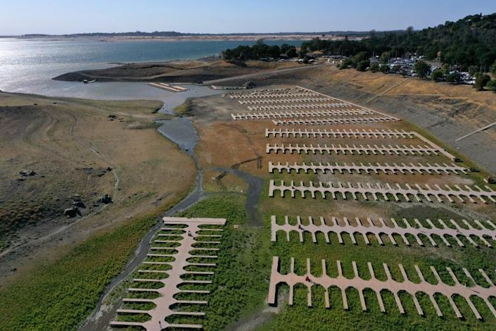 """<div class=""""inline-image__caption""""><p>Boat docks at the Browns Ravine Cove sit on dry earth at Folsom Lake on May 10, 2021 in El Dorado Hills, California. </p></div> <div class=""""inline-image__credit"""">Justin Sullivan/Getty</div>"""
