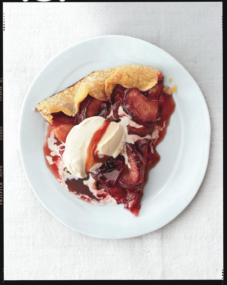 """Port gives this plum dessert added luscious flavor. You'll boil down the wine with allspice and brown sugar before mixing in the plums. <a href=""""https://www.epicurious.com/recipes/food/views/rustic-plum-and-port-tart-242467?mbid=synd_yahoo_rss"""" rel=""""nofollow noopener"""" target=""""_blank"""" data-ylk=""""slk:See recipe."""" class=""""link rapid-noclick-resp"""">See recipe.</a>"""