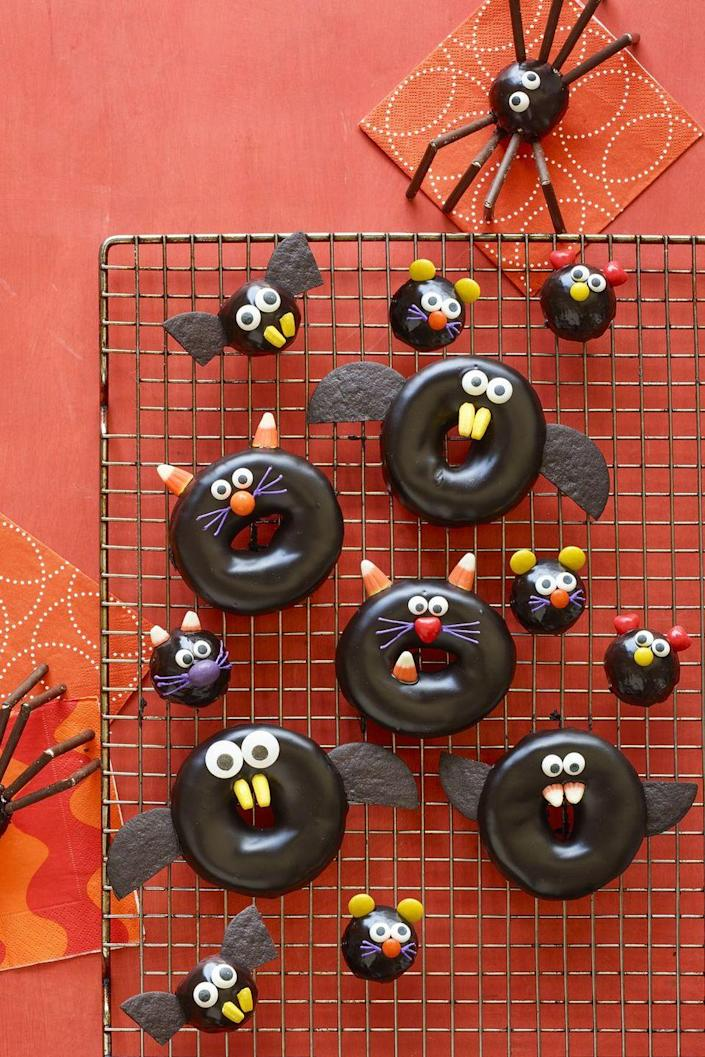 """<p>Kids will swarm around this chocolate-dipped dessert that's frightfully cute.<br></p><p><em><strong><a href=""""https://www.womansday.com/food-recipes/food-drinks/a23460042/black-cat-bat-spider-and-mice-doughnuts-recipe/"""" rel=""""nofollow noopener"""" target=""""_blank"""" data-ylk=""""slk:Get the Black Cat, Bat, Spider, and Mice Doughnut recipe."""" class=""""link rapid-noclick-resp"""">Get the Black Cat, Bat, Spider, and Mice Doughnut recipe.</a></strong></em></p>"""