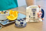 <p>He can have his morning cup of coffee in this <span>Star Wars R2-D2 Ceramic Cup With Lid</span> ($20).</p>
