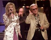 """FILE - In this June 16, 1997 file photo, Country music veteran George Jones bends an ear toward 14-year-old newcomer LeAnn Rimes during the opening segment of the TNN-Music City News Country Awards show in Nashville, Tenn., Jones, the peerless, hard-living country singer who recorded dozens of hits about good times and regrets and peaked with the heartbreaking classic """"He Stopped Loving Her Today,"""" has died. He was 81. Jones died Friday, April 26, 2013 at Vanderbilt University Medical Center in Nashville after being hospitalized with fever and irregular blood pressure, according to his publicist Kirt Webster. (AP Photo/Mark Humphrey, file)"""