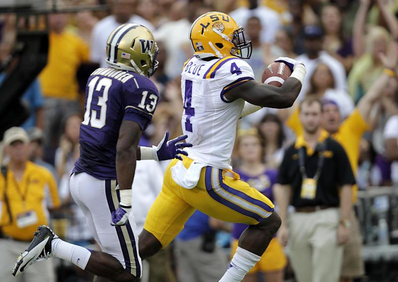 LSU running back Alfred Blue (4) rushes past Washington safety Will Shamburger (13) for a touchdown during the first half of an NCAA college football game in Baton Rouge, La., Saturday, Sept. 8, 2012. (AP Photo/Gerald Herbert)